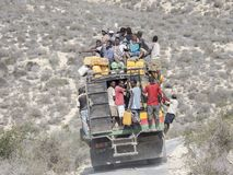 Overcrowded bus on the mountain royalty free stock photography