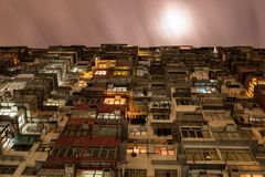 Overcrowded Flat in Hong Kong in a Cloudy Night. Hong Kong is the city where there is huge skycraper, but there is place where people live stuck Royalty Free Stock Images