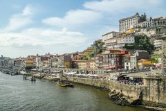Overcrowded riverfront in colorful Ribeira district stock photography