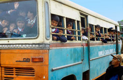 Overcrowded school bus Stock Photo
