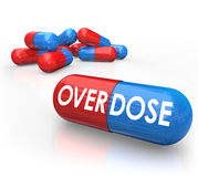 Overdose Word Pills Capsules OD Drug Addiction. Overdose word on pills or capsules to illustrate the dangers of drug addication and overmedication of presription Stock Photo