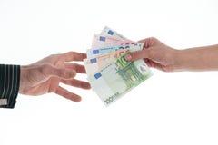 Overdracht van geld Royalty-vrije Stock Foto's