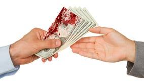 Overdracht van geld tussen de mens en vrouw, bloed royalty-vrije stock foto's