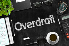 Overdraft Handwritten on Black Chalkboard. 3D Rendering. Black Chalkboard with Handwritten Business Concept - Overdraft - on Black Office Desk and Other Office Royalty Free Stock Image