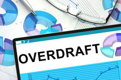 Overdraft on tablet with graphs. Business concept Stock Photography