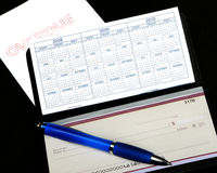 Overdue bill and checkbook Stock Photography