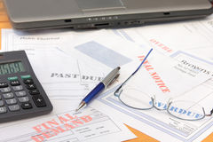 Overdue Bills with Calculator and Laptop. Bankruptcy concept - overdue bills with calculator and laptop Stock Photo