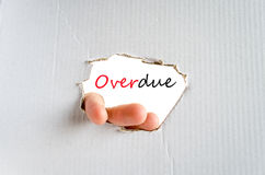 Overdue concept. Hand and text on the cardboard background Overdue concept Royalty Free Stock Photos