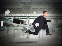 Overdue passenger. Passenger man runs with suitcase in airport Stock Photos