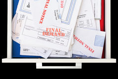 Overdue & Unpaid Invoices in Drawer. Elevated view of a drawer full of unpaid bills Stock Photos
