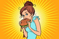 Overeating fast food. Woman secretly eating a Burger Royalty Free Stock Photos