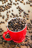 Overfilled coffee cup Royalty Free Stock Photography