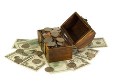 Overfilled with coins and dollars chest Stock Photo
