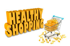 Overfilled shopping cart filled with yellow orange omega 3 capsules Stock Photography