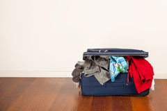 Overfilled suitcase Royalty Free Stock Photos