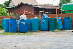 Overfilled trash of large wheelie bins for rubbish, recycling Royalty Free Stock Image
