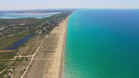 Overflight along coast of turquoise sea, aerial video. Overflight along places of tourist stay near turquoise sea, aerial video stock video footage