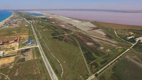 Pink salt lakes and turquoise sea, aerial video. Overflight along places of tourist stay near pink salt lakes and turquoise sea, aerial video stock video