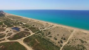 Overflight along coast of turquoise sea, aerial video. Overflight along places of tourist stay near turquoise sea, aerial video stock footage