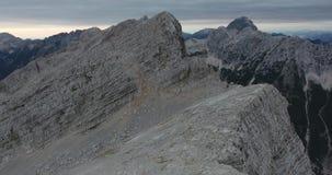 Overflight of mountain ridge and peaks. stock footage