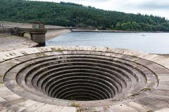 Overflow drain at Ladybower Reservoir. Concrete Overflow drain at Ladybower Reservoir. Reservoir water very low due to lack of rain fall Stock Photo