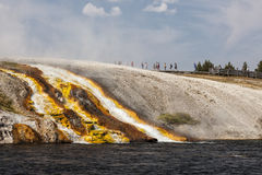 Overflow from Excelsior Geyser runs into the Yellowstone River Stock Photos