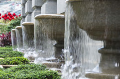 Overflow Fountain. Building decoration and aesthetic row of flowing water fountain Royalty Free Stock Photo