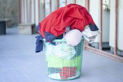Overflow laundry cloth plastic basket. stock photos