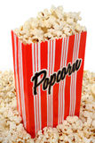 Overflowing bag of popcorn Stock Images