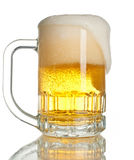 Overflowing beer. Close up shot of overflowing full beer mug  over white Royalty Free Stock Photography