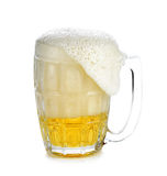 Overflowing beer glass, holding  white background Royalty Free Stock Photography