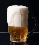 Overflowing beer Stock Image