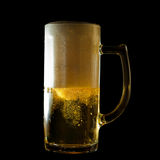 Overflowing beer mug Royalty Free Stock Image