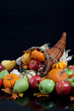 An overflowing cornucopia on a black background Royalty Free Stock Photo