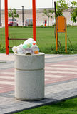 Overflowing garbage bin Royalty Free Stock Photos