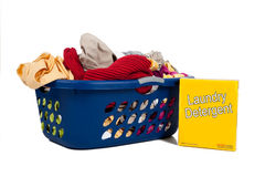 Overflowing laundry Basket with detergent Stock Images