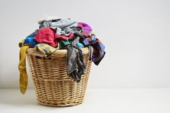 Overflowing laundry basket. Household chore concept on white background royalty free stock photos