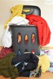 Overflowing laundry basket Stock Image