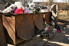 Overflowing litter bin. garbage bins are overfilled with packages with waste stock photography