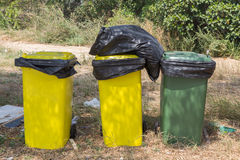 Overflowing of Three litter bins.  Stock Image