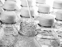 Water filling clear bottles Royalty Free Stock Photography