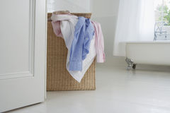 Overflowing Wicker Laundry Basket Stock Images