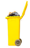 Overflowing yellow bin Stock Photo