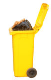 Overflowing yellow recycling bin, clipping path. Royalty Free Stock Photography