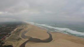 Overflying an Atlantic beach stock video footage