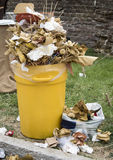 Overfull garbage can trash in festival. Overfull food garbage can trash during a traditional village festival Royalty Free Stock Image