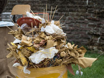 Overfull garbage can trash in festival. Overfull food garbage can trash during a traditional village festival Royalty Free Stock Images