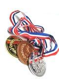 Overgehelde medailles stock afbeelding