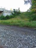 Overgown Underpass. An overgrown side of a hill by an underpass Stock Photography