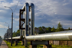 Overground heat pipes. Pipeline above the earth conducting heat for heating city Royalty Free Stock Images